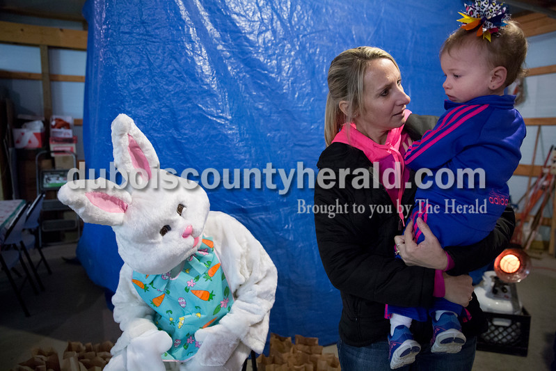 Sarah Ann Jump/The Herald<br /> Brandi Dodd of Dubois consoled Ashtyn Kalb of Dubois, 1, who was afraid of the Easter Bunny, during Breakfast with the Easter Bunny sponsored by the Dubois Ruritan Club at Dubois Community Park on Saturday.