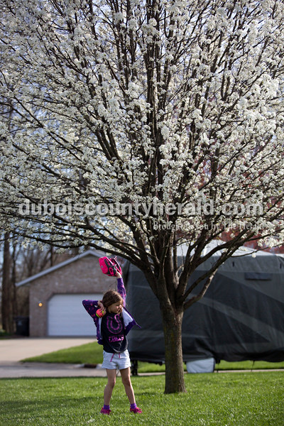 Alisha Jucevic/The Herald <br /> <br /> Hadley Nowotarski, 5, practiced catching and throwing with her dad, Ben, in their front yard in Jasper on Tuesday evening. Ben took advantage of the sunny evening to practice hitting and catching with his daughters, Hadley, and her older sister, Emma, 7, before their T-ball season starts next week. Their younger brother, Beckett, 1, chased the balls and played next to them as they practiced. Ben said him and his wife, Holly, try to get the girls involved in as much as they can to see what they like as they grow up.