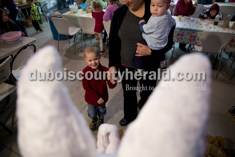 Sarah Ann Jump/The Herald<br /> Kelli Faulkenberg of Dubois brought her sons Garrett, 4, and Mitch, 1, to meet the Easter Bunny during Breakfast with the Easter Bunny sponsored by the Dubois Ruritan Club at Dubois Community Park on Saturday. Mitch was scared at first but warmed up after encouragement from his brother. Due to rain, the Easter egg hunt was cancelled and children received a bag of prize-filled eggs when they visited the bunny. Each of the approximately 70 children that attended also received a children's book of their choice.