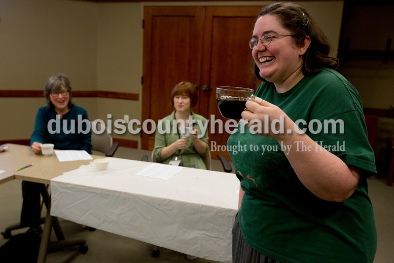 Ariana van den Akker/The Herald<br /> Holding a cup of pu erh tea, Erin Doyle of Jasper giggled at Lynn Belli of Ferdinand's strong reaction to the smell of the tea leaves during a tea tasting class that Doyle taught at the Ferdinand Branch Library on Thursday. Participants tasted and learned about the different types of tea. Though pu erh is her favorite type of tea, Doyle admits that its strong smell and taste can be off-putting for some people.