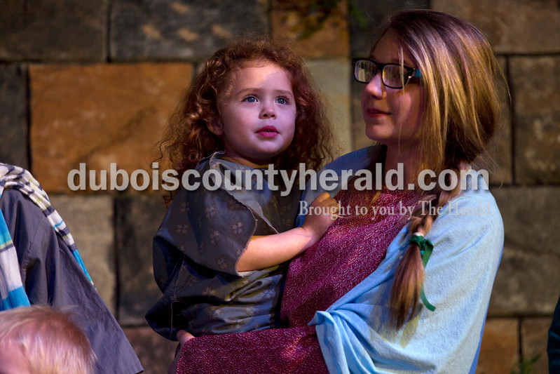 "Alisha Jucevic/The Herald <br /> <br /> Lauren Goad of Jasper, 14, held Elizabeth David of Jasper, 3, during Wednesday night's dress rehearsal of ""One Voice,"" a dramatic Easter musical, at Victory Temple Assembly of God in Jasper."