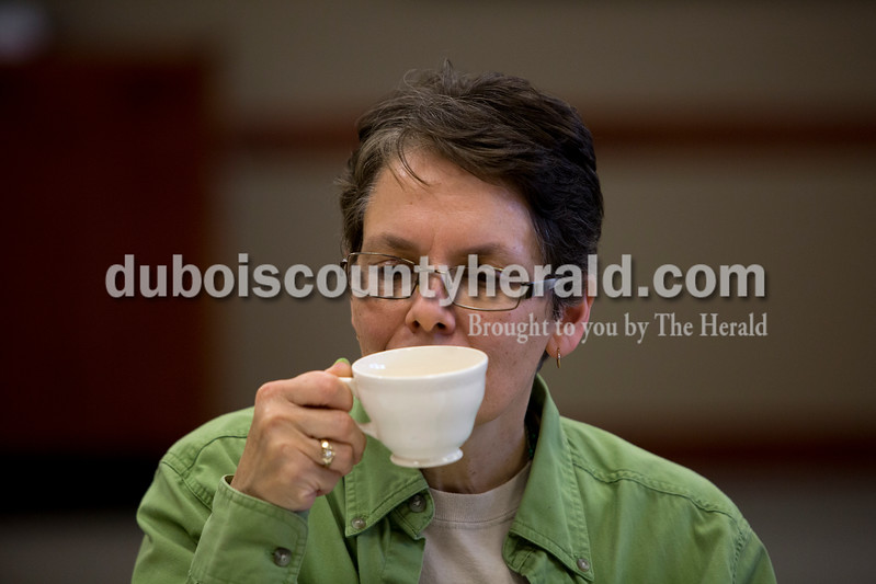 Ariana van den Akker/The Herald<br /> Lynn Belli of Ferdinand smelled gunpowder, a type of green tea, before drinking it during a tea tasting class taught by Erin Doyle of Jasper at the Ferdinand Branch Library on Thursday. Participants tasted and learned about the different types of tea.