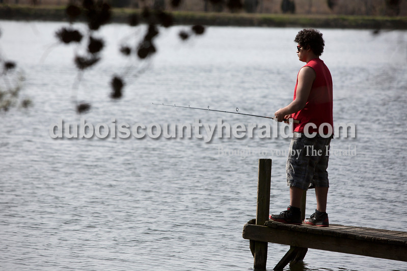 "Ariana van den Akker/The Herald<br /> Anthony Hudson of Huntingburg, 16, fished at Holland Lake in Holland on Tuesday afternoon. Hudson was taking advantage of the nice weather during spring break to try his luck fishing in Holland. He didn't catch anything though. ""It's just one of those days,"" Hudson said."