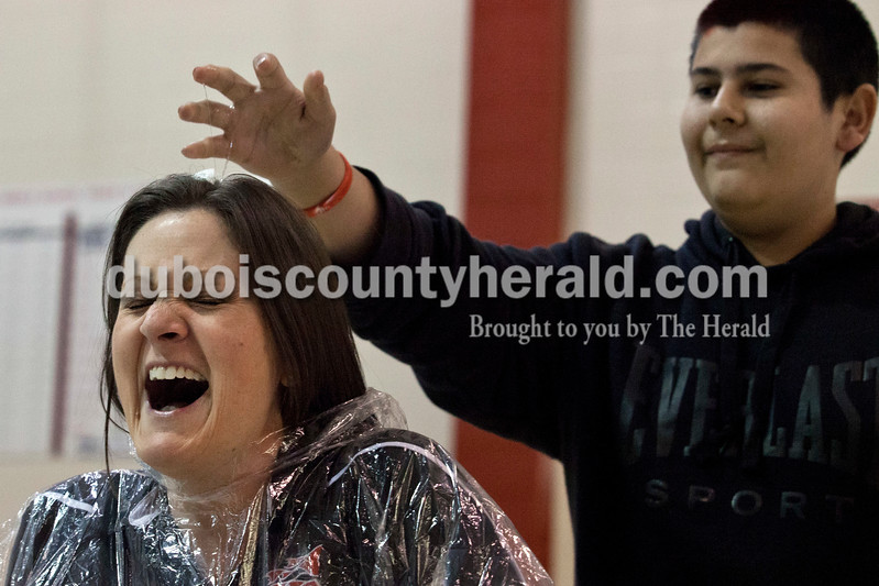 Alisha Jucevic/The Herald <br /> <br /> Southridge Middle School ended their week of fundraising for Riley Hospital for Children in Indianapolis with a pep rally and an egg roulette game. Principal Annette Altmeyer reacted as seventh-grader Jose Sandoval smashed a raw egg on her head during on pep rally on friday afternoon in Huntingburg. Ten teachers entered their names and had to have at least $25 raised in their name, $50 for the principal, to play roulette. Seven teachers, including principal   Annette Altmeyer, raised enough to play. Throughout the week $2394.67 was raised, $243.94 of that from the roulette game.