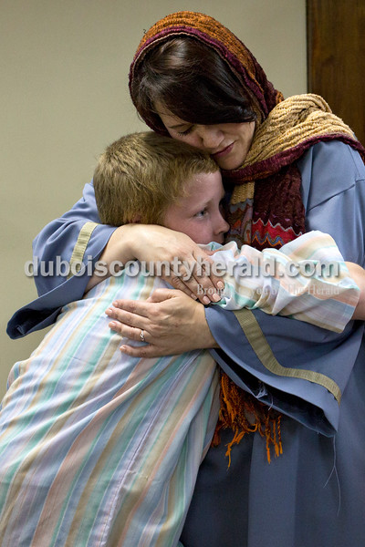 "Alisha Jucevic/The Herald <br /> <br /> Michelle Bayer embraced her son Aaron, 10, both of Jasper before  Wednesday night's dress rehearsal of ""One Voice,"" a dramatic Easter musical, at Victory Temple Assembly of God in Jasper. Bayer said she likes being a part of the yearly plays. ""You build relationships,"" she said. ""It's like a family atmosphere."""