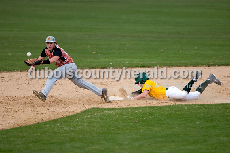 Forest Park's Trever Zink slid safely to second base as Crawford County's Brenden Kannapel reached for the ball during Wednesday's game in Ferdinand. The Rangers won 2-0. Ariana van den Akker/The Herald