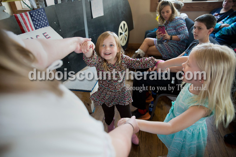 Sarah Ann Jump/The Herald<br /> Gayle Parks Smith of Huntingburg danced with cousins Marissa Wolf of Jasper, 4, center, and Lexi VanPelt of Huntingburg, 4, during Saturday's show at the Huntingburg Opry Hall.