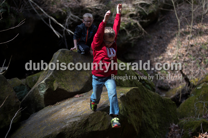 Grant Wehr of Jasper, 6, right, and his brother, Alec, 8, climbed on boulders together March 6.<br /> Dave Weatherwax/The Herald
