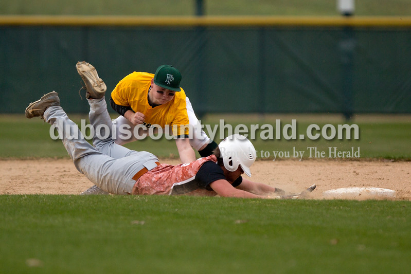 Forest Park's Jaxon Cronin tagged Crawford County's Brenden Kannapel out at second during Wednesday's game in Ferdinand. The Rangers won 2-0. Ariana van den Akker/The Herald