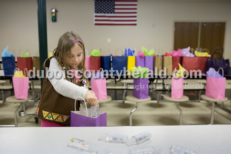 Sarah Ann Jump/The Herald<br /> Isabelle Meyer of Jasper, 8, added hand sanitizer to a gift bag for chemotherapy patients at Memorial Hospital during Girl Scout Troop 670's meeting at Fifth Street Elementary School in Jasper on Monday.