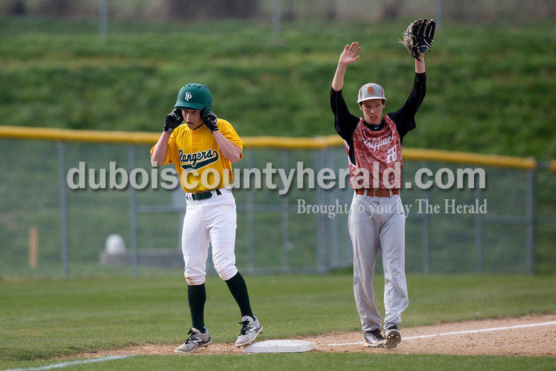 Forest Park's Evan Dilger made it safely to third base as Crawford County's Noah Sturgeon called for the ball during Wednesday's game in Ferdinand. The Rangers won 2-0. Ariana van den Akker/The Herald