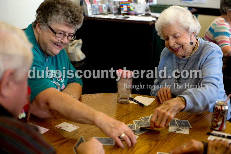 Ariana van den Akker/The Herald<br /> Susie Stemle, left, and Ruth King, both of Huntingburg, picked cards to see who would deal first during a euchre tournament at the Huntingburg Senior Center on Monday. The senior center has the tournaments twice a month.