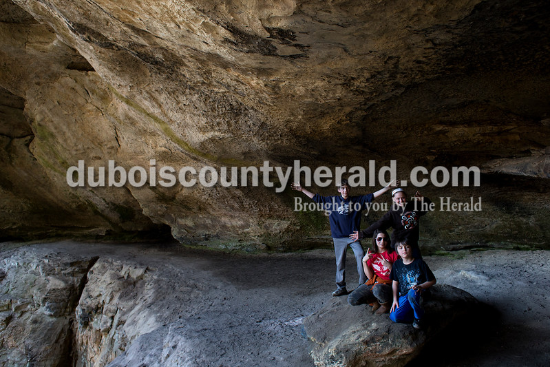 Austin Mattingly, 13, Desi Puckett, 13, and Kylie Puckett, 14, all of Leavenworth, and Zander Sattler of English, 10, posed for a photograph under the large overhang at Hemlock Cliffs on March 6. Dave Weatherwax/The Herald