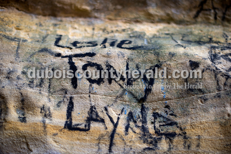 Many visitors to Hemlock Cliffs mark that they visited the site by writing their names on cliff walls, in moss on boulders and in trees along the trails. Dave Weatherwax/The Herald