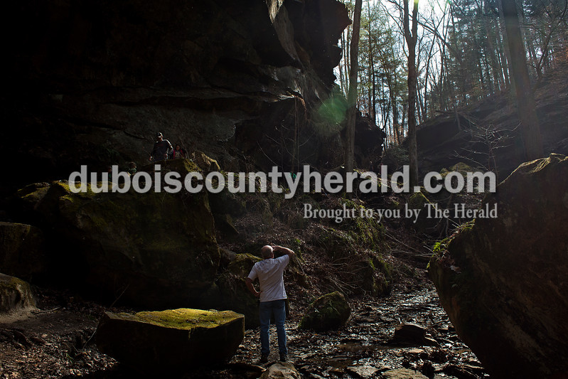 Tom Knies of Jasper glanced up from the bottom of the canyon at Hemlock Cliffs while hiking with family and friends March 6.<br /> Dave Weatherwax/The Herald
