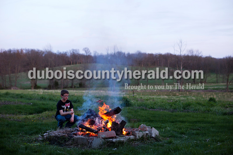 Alisha Jucevic/The Herald <br /> <br /> Ethan Hawkins of Washington, 11, roasted hotdogs over a fire in his father's backyard on Tuesday evening in Maltersville. Ethan was visiting his father, Shawn, for spring break and after they spent the afternoon fishing Shawn asked Ethan what he wanted for dinner. They try to have fires often outside once the weather is nice out, so Ethan suggested roasting hotdogs over a bonfire for dinner.