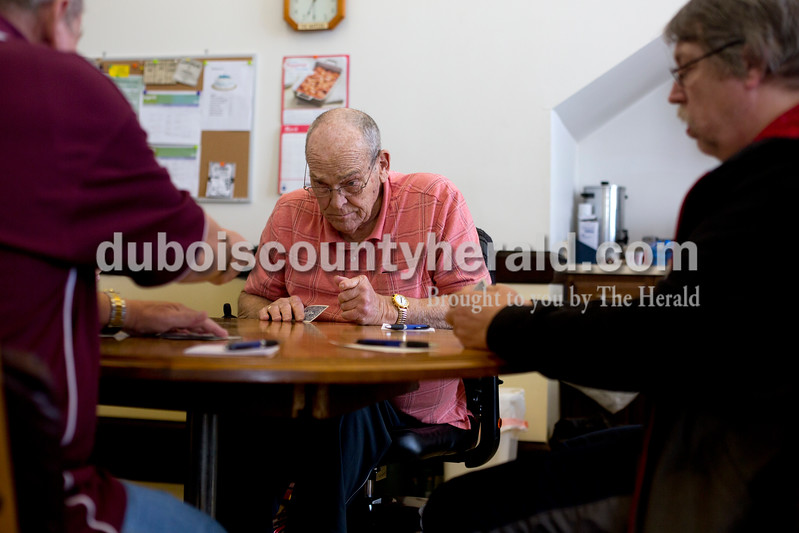 Ariana van den Akker/The Herald<br /> John Wirthwein of Huntingburg watched what cards were played during a euchre tournament at the Huntingburg Senior Center on Monday. The senior center has the tournaments twice a month. Wirthwein said he's been playing euchre for about 75 years.