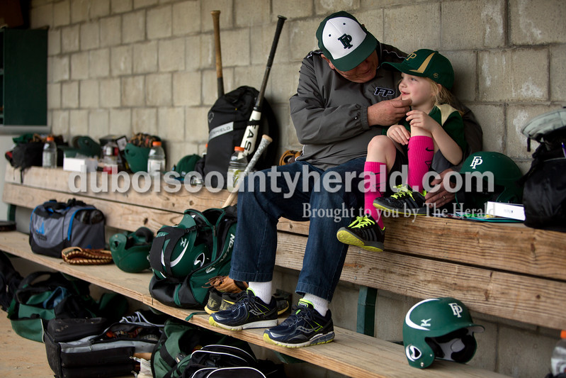 Ariana van den Akker/The Herald<br /> Dwight Howard of Santa Claus and his granddaughter Bree Howard of Ferdinand, 5, hung out in the Ranger dugout before the Forest Park baseball game against Crawford County on Wednesday. Bree's dad (and Dwight's son) is Forest Park baseball head coach Jarred Howard.