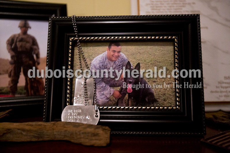 Alisha Jucevic/The Herald <br /> Tony Neal of Jasper is pictured with one of the dogs he worked with in the United States Air Force, Ares, on his last day of service in September 2014. Neal was an E-5 staff sergeant and K9 handler.