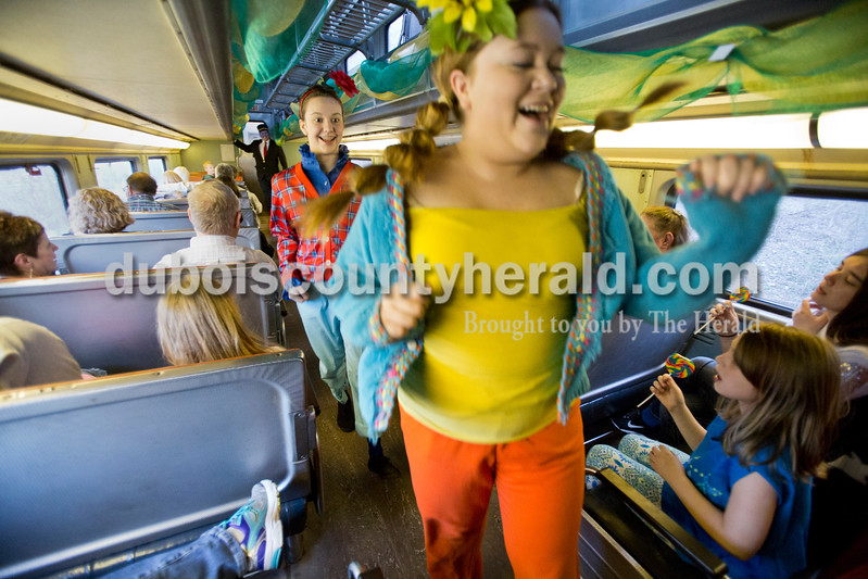 "Sarah Ann Jump/The Herald<br /> Playing munchkins, Kylie Schweikarth of Celestine, 15, left, and Nicole Kress of Jasper, 17, skipped down the aisle as they sang ""Follow the Yellow Brick Road"" during the Wizard of Oz Train Ride on the French Lick Scenic Railroad on Friday."
