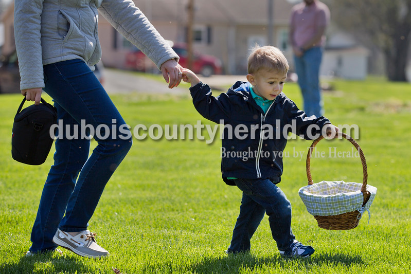 Sarah Ann Jump/The Herald<br /> Sam Erny of Jasper, 3, pulled his mother Ashley Erny along as he looked for eggs during Saturday's Easter egg hunt sponsored by the Haysville Ruritan Club at St. Paul Lutheran Church in Haysville.