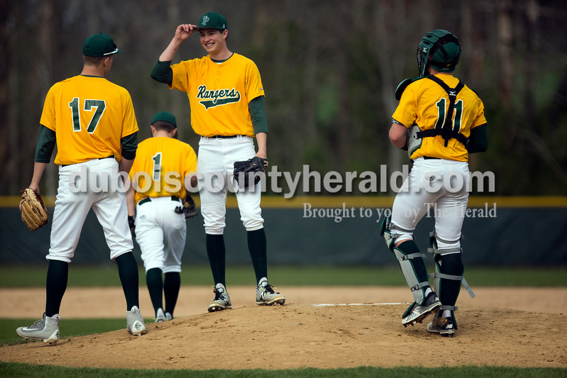 Forest Park's Ben Wendholt, left, Jaxon Cronin and Eli Knust met on the pitcher's mound before the first inning of Wednesday's game against Crawford County in Ferdinand. The Rangers won 2-0. Ariana van den Akker/The Herald