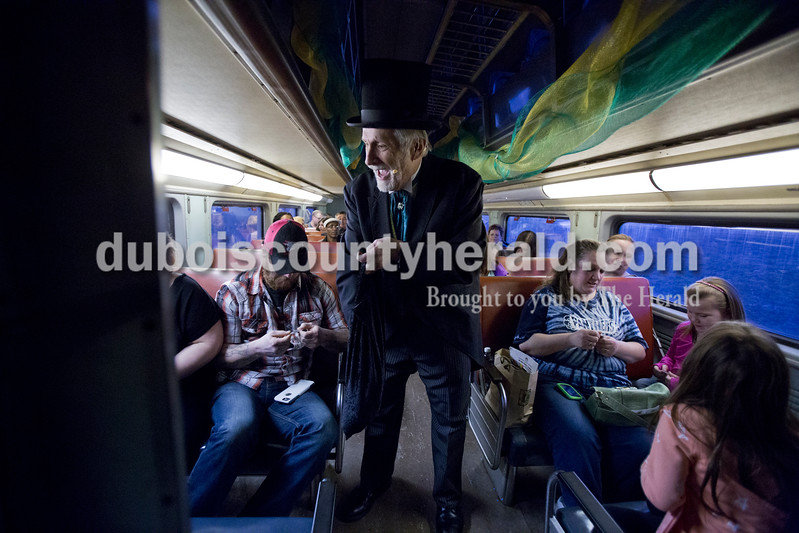 Sarah Ann Jump/The Herald<br /> Chuck Jones of Bedford, portraying the wizard, passed out candy coins during the Wizard of Oz Train Ride on the French Lick Scenic Railroad on Friday.