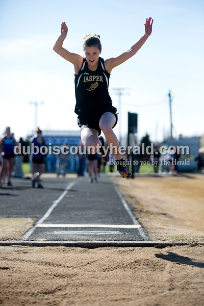 Jasper's Amanda Ackerman competed in the long jump during Tuesday afternoon's track meet against Northeast Dubois at Jerry Brewer Alumni Stadium in Jasper. Ariana van den Akker/The Herald