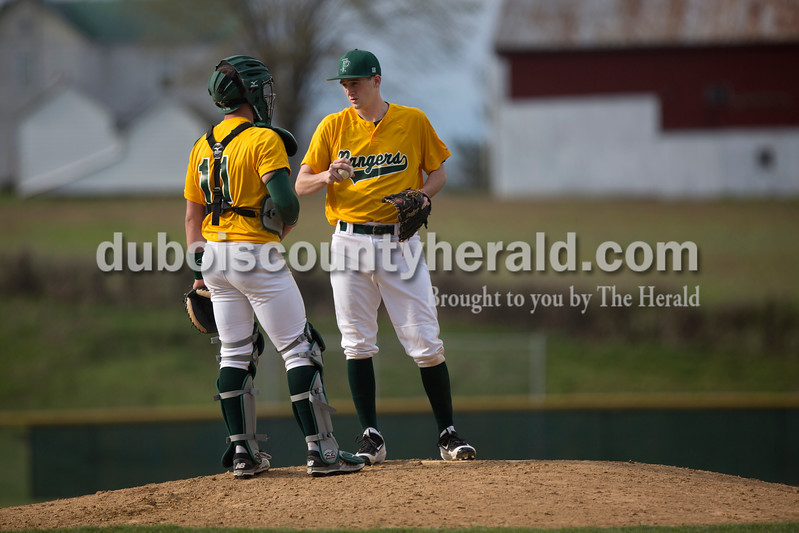 Forest Park's Eli Knust, left, and David Lusk conferred on the mound during Wednesday's game against Crawford County in Ferdinand. The Rangers won 2-0. Ariana van den Akker/The Herald