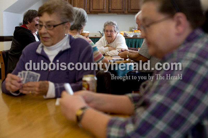 Ariana van den Akker/The Herald<br /> Marjorie Lampert of St. Anthony, center, chatted while playing euchre during a euchre tournament at the Huntingburg Senior Center on Monday. The senior center has the tournaments twice a month. (Jeanette Boeglin of Huntingburg is on the left).