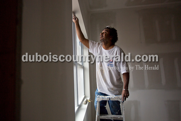 Alisha Jucevic/The Herald   Luis Funez of Jasper dusted off the window siding before applying caulking in the new section of apartments at The Lofts at St. Joseph's, the site of the former St. Joseph's Hospital, on Thursday morning in Huntingburg. This apartment complex will be community exclusively for adults 55 and over and will be welcoming residents in June 2016.