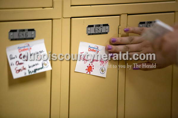Ariana van den Akker/The Herald Jasper High School sophomore Samantha Schuetter stuck encouraging notes onto lockers after school on Thursday afternoon. About a dozen members of the Friends of Rachel Club wrote the notes and stuck them on every student's locker throughout the school. The club, named after a student who died in the Columbine High School shooting in 1999, encourages reaching out to others with kindness and empathy.