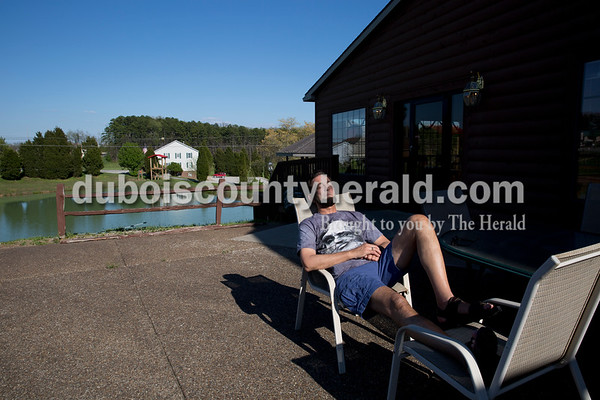 Ron Carley of Detroit relaxed after a day of touring Indiana and Kentucky at Santa's Lodge in Santa Claus on April 16.