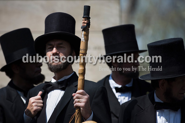 Larry Elliott of Louisville, Ky. holds a custom-made Abraham Lincoln cane during a group photo of the Association of Lincoln Presenters at Bicentennial Plaza in Lincoln State Park in Lincoln City on April 15. Elliott's great-great-great-great grandmother was Mary Brooks La Rue, the midwife that delivered Abraham Lincoln when he was born on Feb. 12, 1809. The Association of Lincoln Presenters held their annual conference in Santa Claus last weekend, coinciding with the bicentennial anniversary of when the Lincoln family moved to the Spencer County area in 1816 and the date of Lincoln's death on April 15, 1865.