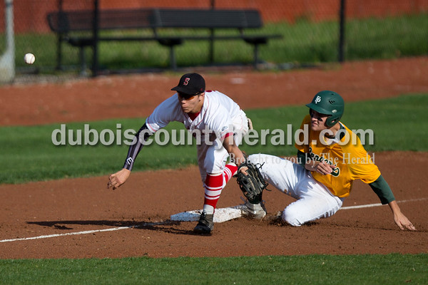 Forest Park's Ben Wendholt slid safely into third base as Southridge's Ross Eckert missed a pass during Friday evening's game at League Stadium in Huntingburg. The Rangers won 5-4. Ariana van den Akker/The Herald