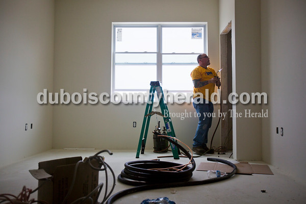 Alisha Jucevic/The Herald   Kevin Talbert of Evansville, with BNG Heating & Cooling, worked on the heating and air system at The Lofts at St. Joseph's, the site of the former St. Joseph's Hospital, on Thursday morning in Huntingburg. This apartment complex will be community exclusively for adults 55 and over and will be welcoming residents in June 2016.