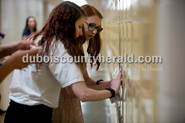 Ariana van den Akker/The Herald Jasper High School seniors Tia Gramelspacher, left, and Kelly Hughes stuck encouraging notes onto lockers after school on Thursday afternoon. About a dozen members of the Friends of Rachel Club wrote the notes and stuck them on every student's locker throughout the school. The club, named after a student who died in the Columbine High School shooting in 1999, encourages reaching out to others with kindness and empathy.