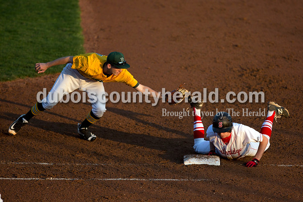 Southridge's Gaage Fetter dove back to first base as Forest Park's David Lusk tried to force an out during Friday evening's game at League Stadium in Huntingburg. The Rangers won 5-4. Ariana van den Akker/The Herald