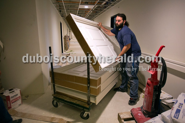 Alisha Jucevic/The Herald    Alex Tepe of Petersburg moved interior doors to the new section of apartments at The Lofts at St. Joseph's, the site of the former St. Joseph's Hospital, on Thursday morning in Huntingburg. This apartment complex will be community exclusively for adults 55 and over and will be welcoming residents in June 2016.