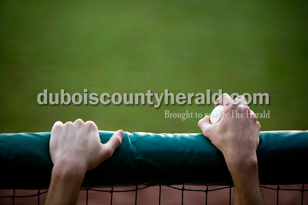 Forest Park's David Lusk held onto a ball as he watched from the dugout during Friday evening's game against Southridge at League Stadium in Huntingburg. The Rangers won 5-4. Ariana van den Akker/The Herald
