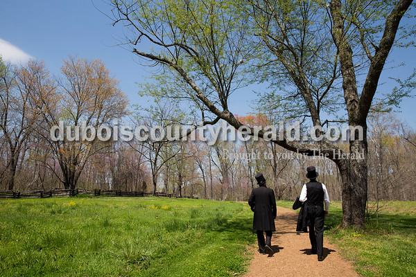John Cooper of Pickerington, Ohio, left, and Robert Brugler of Worthington, Ohio walked along the fields at the Lincoln Living Historical Farm at Lincoln Boyhood National Memorial in Lincoln City on April 15. The farm is located on four of 160 acres originally owned by Thomas Lincoln, father of Abraham.