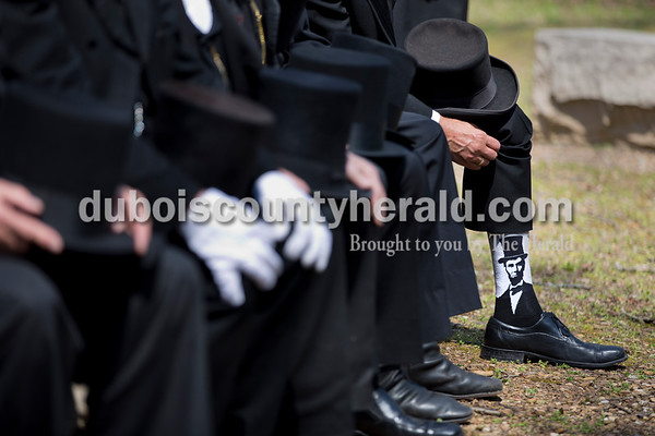Ron Carley of Detroit showed off his Abraham Lincoln socks during a group photo of the Association of Lincoln Presenters at Bicentennial Plaza in Lincoln State Park in Lincoln City on April 15.