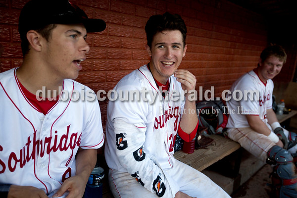 Southridge's Ross Eckert, left, Payton Mattingly and Chad Meyer joked around in the dugout during Friday evening's game against Forest Park at League Stadium in Huntingburg. The Rangers won 5-4. Ariana van den Akker/The Herald
