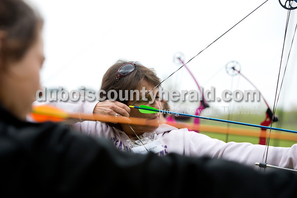 """Ariana van den Akker/The Herald Janet Roberts of Owensboro, Ky. lined up her shot during an archery class on Saturday during the Women's Wilderness Weekend event at Patoka Reservoir. """"It's relaxing,"""" Roberts said. """"I could do this all day."""""""