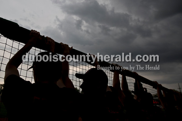 Sarah Ann Jump/The Herald Southridge baseball players watched the game from the dugout as a storm rolled in during Tuesday's game against Washington High School at League Stadium in Huntingburg. The game was cancelled after a weather delay.