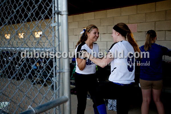 Northeast Dubois' AJ Kirchoff, right, congratulated teammate Melanie Roberts after Roberts' hit allowed Harlee Zehr to score a walk off run during Monday evening's game against Southridge in Dubois. The Jeeps won 7-6. Ariana van den Akker/The Herald
