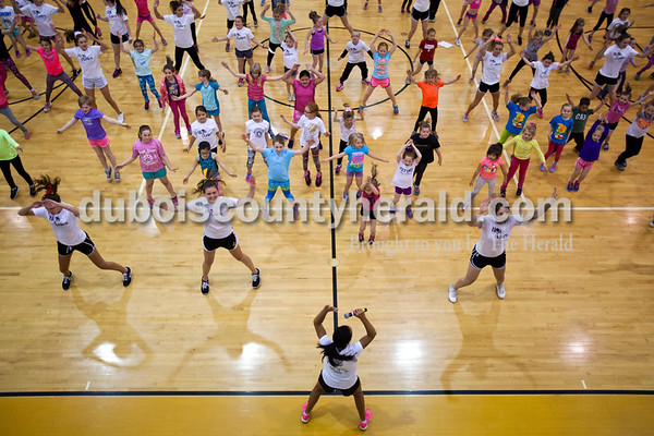 """Jill Wigand led more than 160 girls in a warm up workout during the first High Ponies session at on April 5 at Jasper Middle School. Many of the students from the Jasper High School dance team volunteer to help Jill with the program. Jill says the program is one of her proudest accomplishments. """"I tear up when they start and I tear up when it ends,"""" she said."""