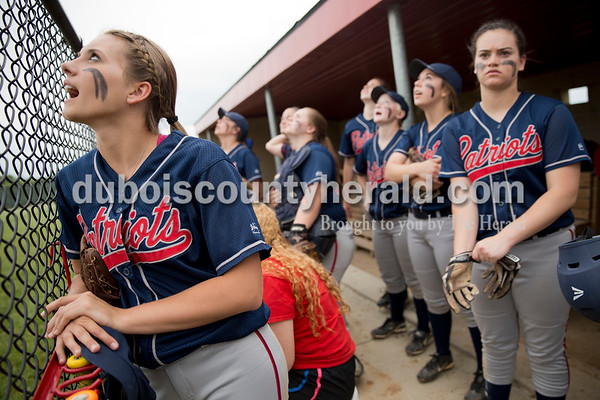 Heritage Hills' Kayley Bauer and her teammates watched a foul ball fly during Friday's game at Southridge High School in Huntingburg. The Patriots beat the Raiders 9-3. Sarah Ann Jump/The Herald
