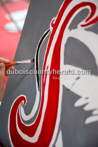 Sarah Ann Jump/The Herald Southridge High School senior Tori Silvers of Huntingburg, 18, painted the Southridge logo on a canvas during a seniors painting night at Teen Outback in Huntingburg on Wednesday.
