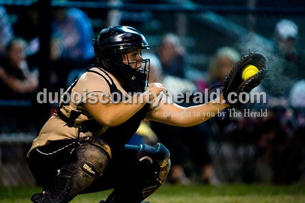 Jasper's Lindsay Mehringer caught the ball during Thursday night's game against Boonville in Jasper. The Wildcats won 11-3. Ariana van den Akker/The Herald